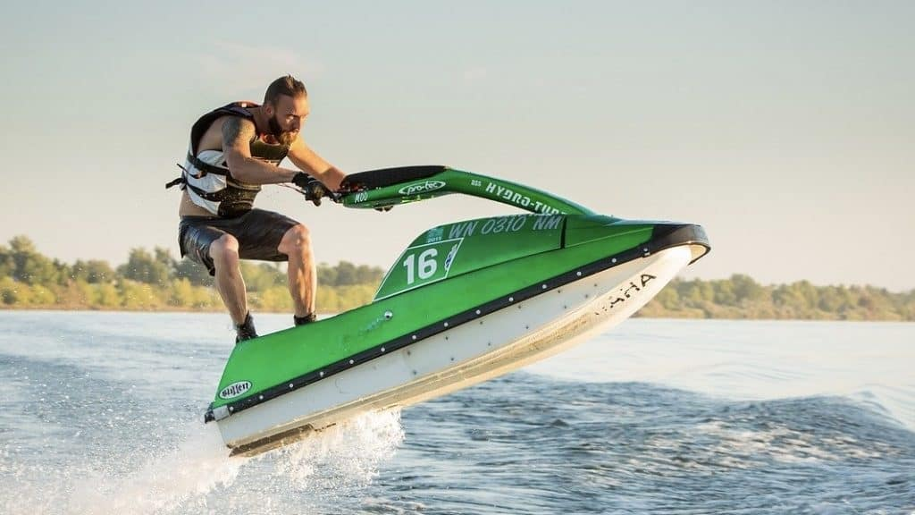 Green stand up jet ski jumpin