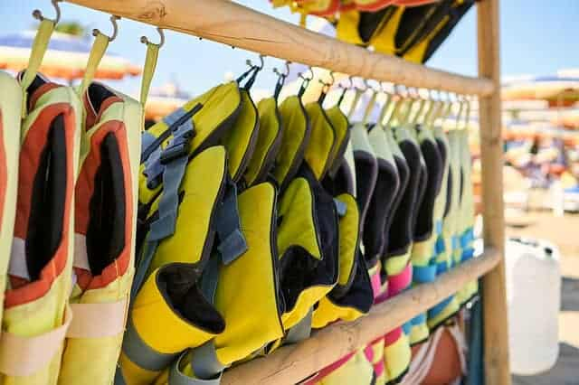 A rack of life jackets for jet skiers to wear for safety