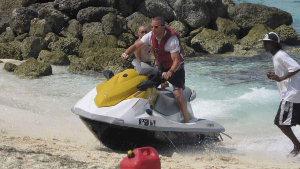 Riding a jet ski straight onto the beach