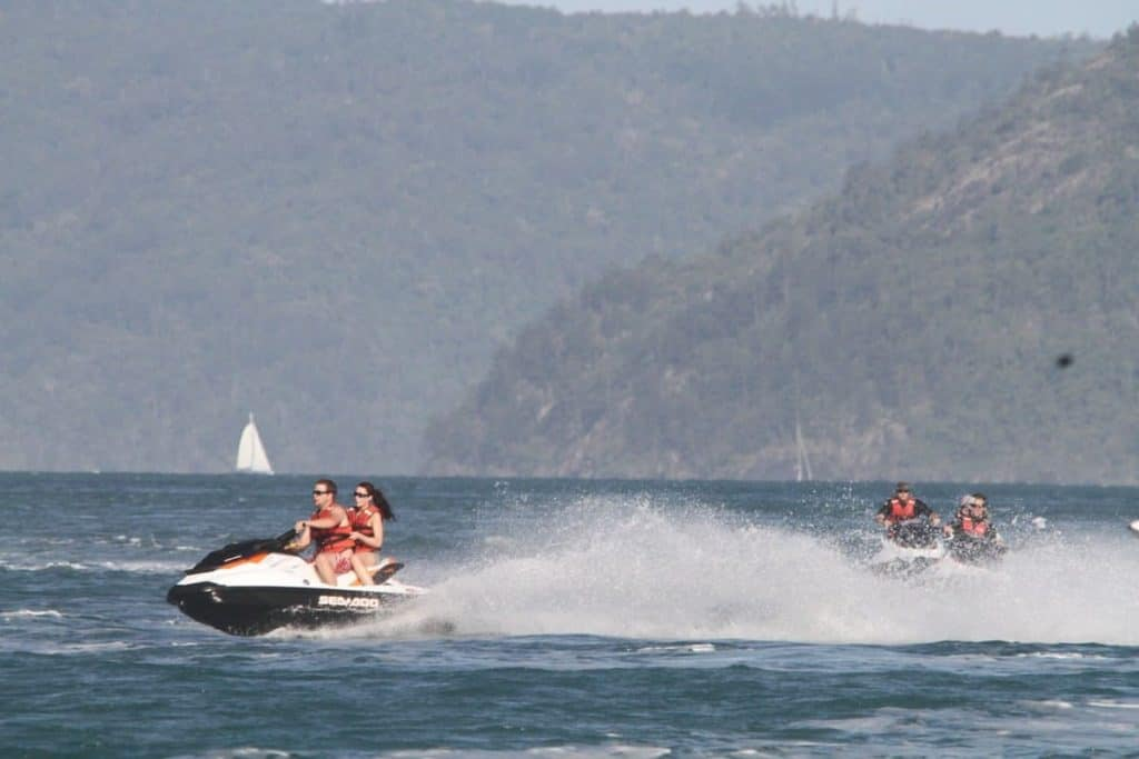 Example of riding a Sea-Doo with a passenger at high speed and others following