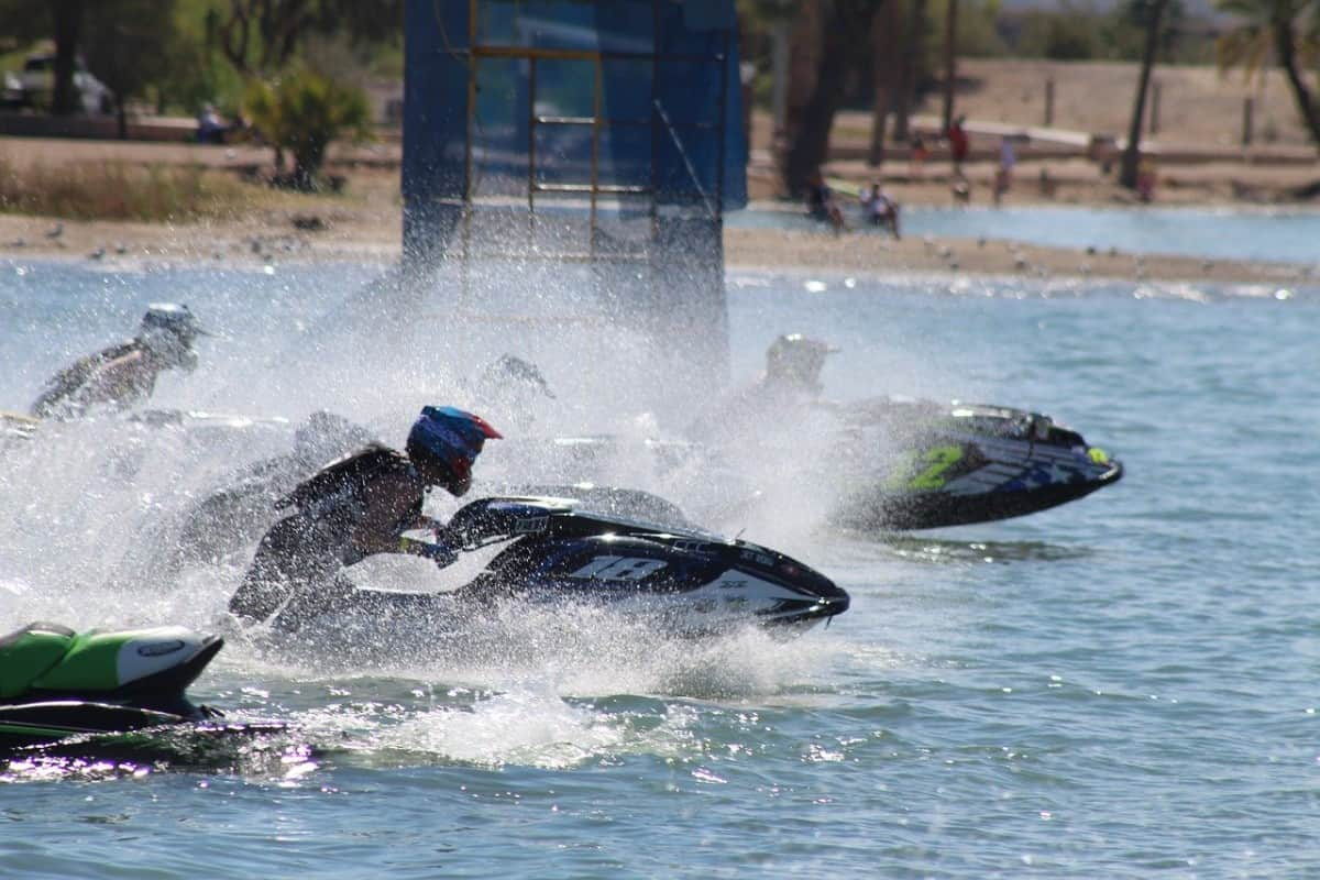 Jet ski racers wear helmets to improve safety and reduce head injury risk