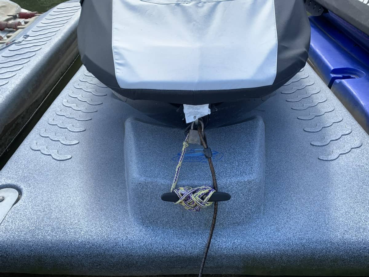Brass waterproof lock on my SeaDoo front hook with cable attached to dock