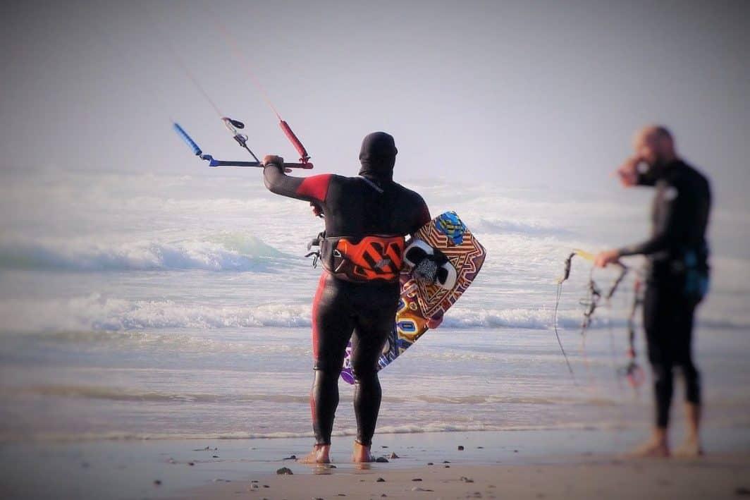 Trimming kite on beach photo