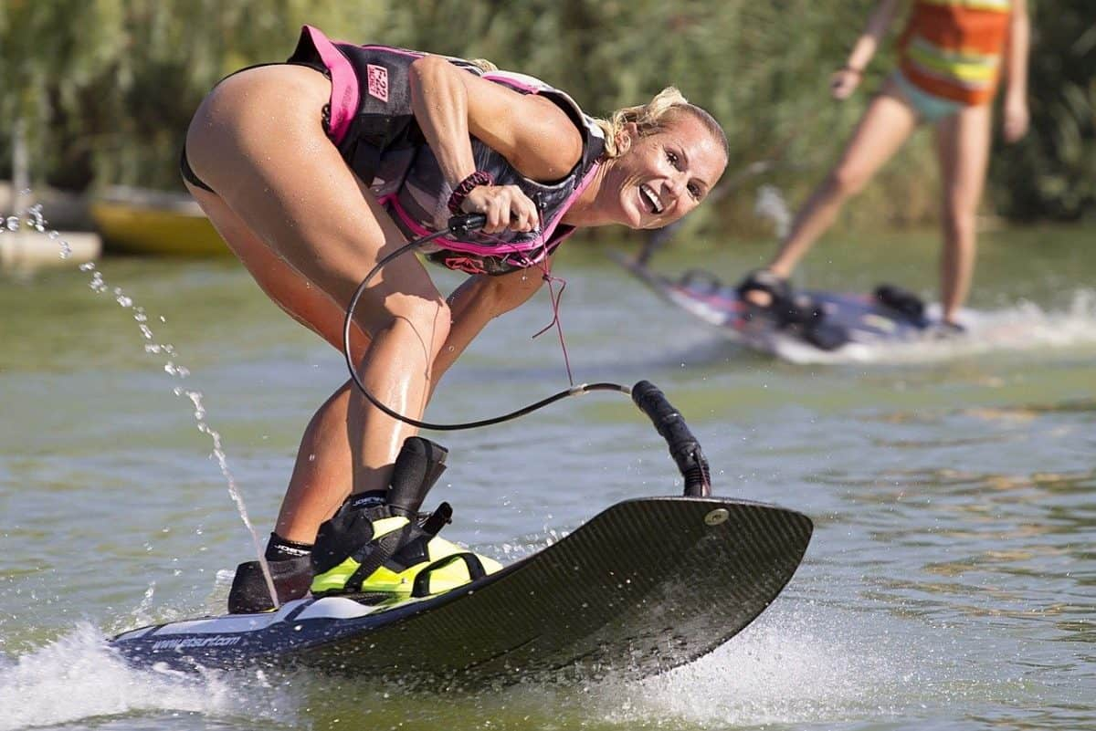 Photo of woman leaning forward on electric surf board