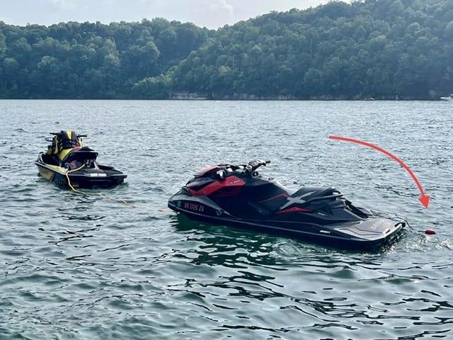 Two Sea Doos anchored on a lake
