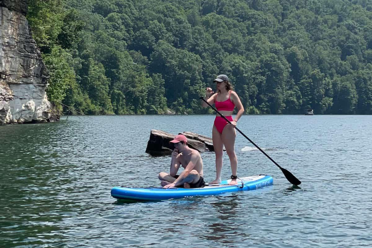 photo of my daughter and boyfriend on iRocker Nautical paddle board on lake
