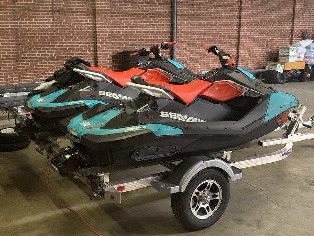 Sea Doo Sparks in blue and red colors on double trailer