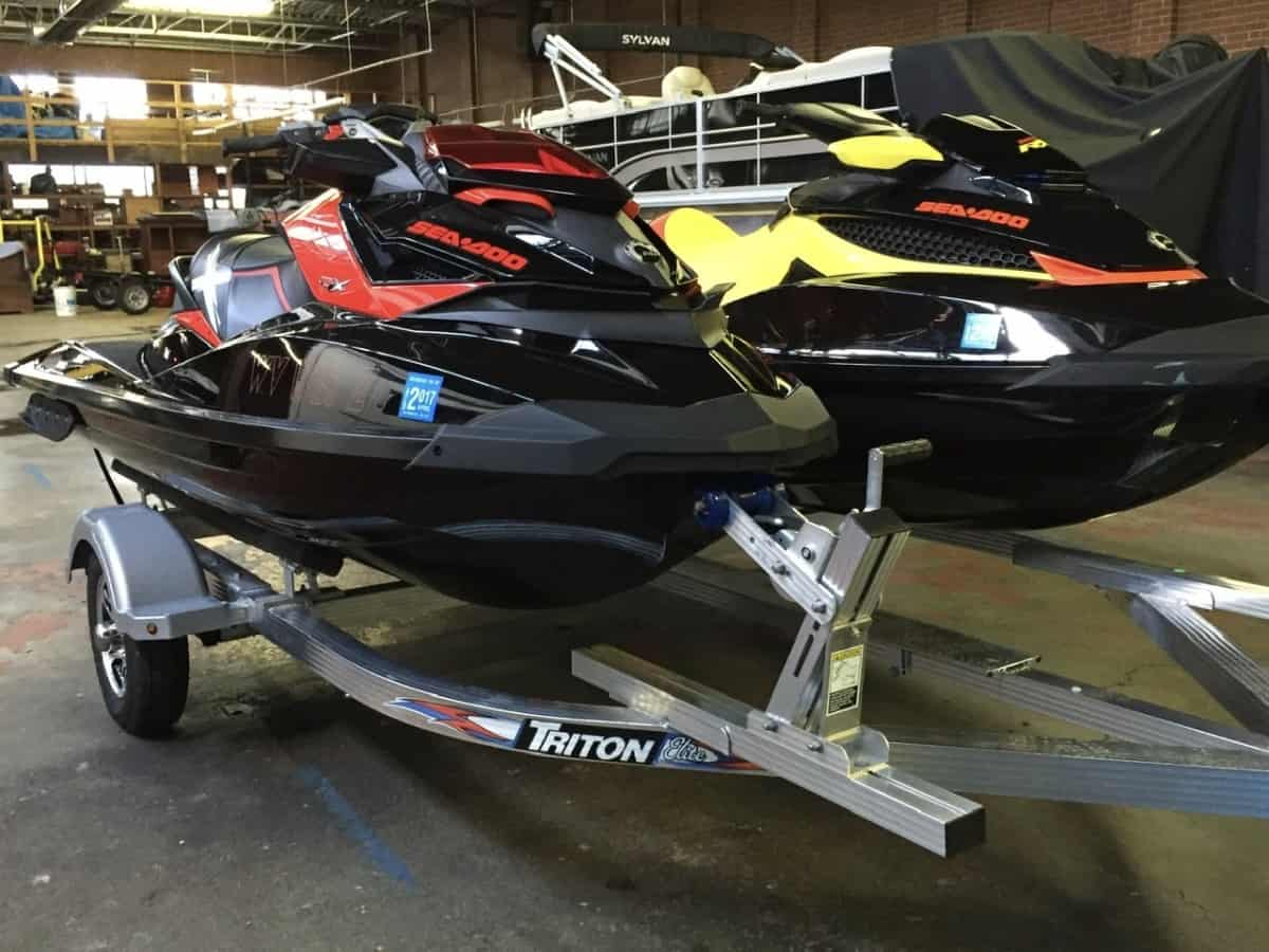 Double Sea Doo loaded aluminum trailer can still be towed by most cars
