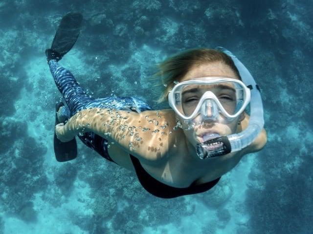 Free divers will need to clear their snorkel of water at surface. 3 methods described here.
