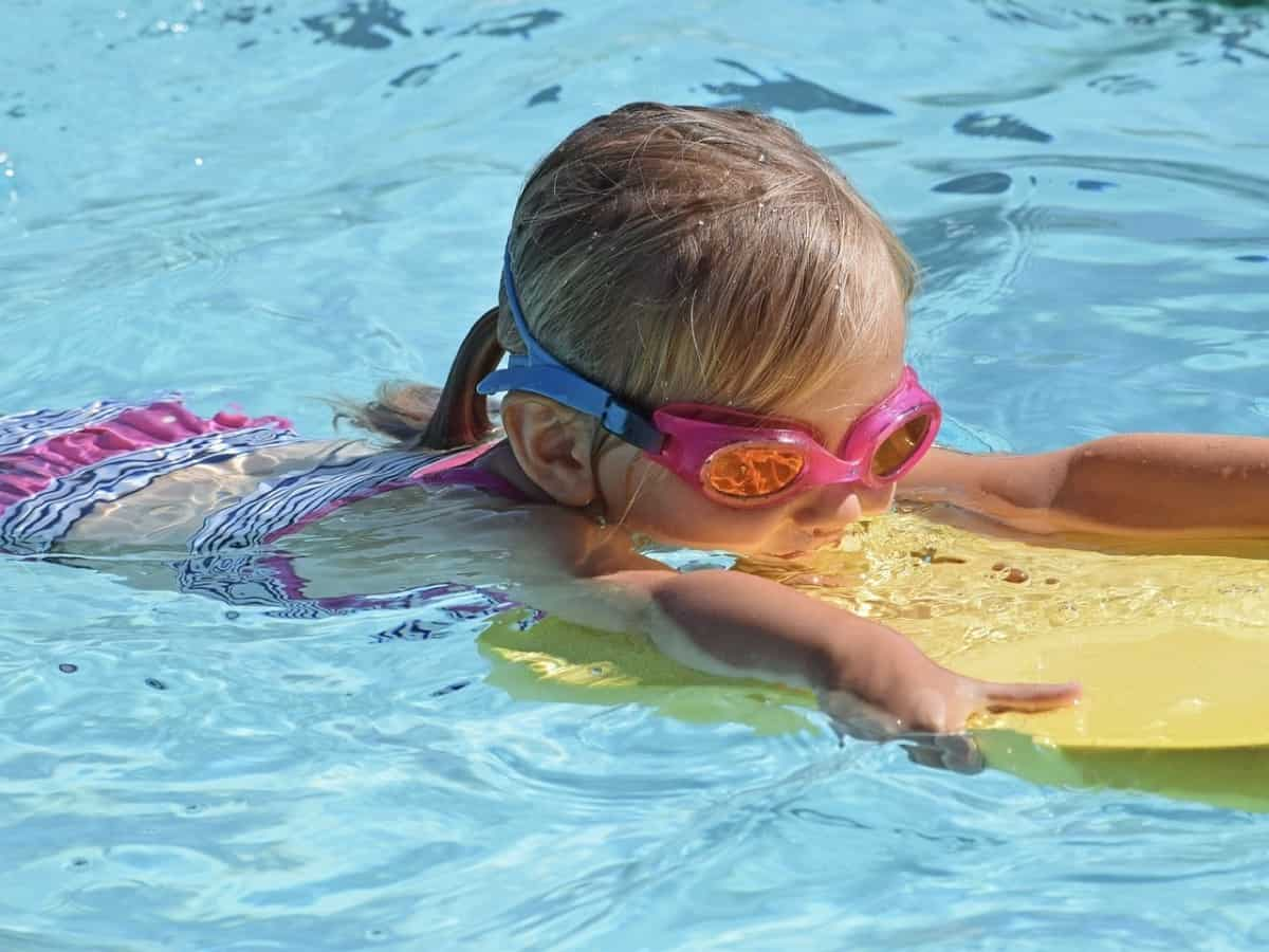 Snorkeling is great exercise just as this little girl at swim practice swimming laps.