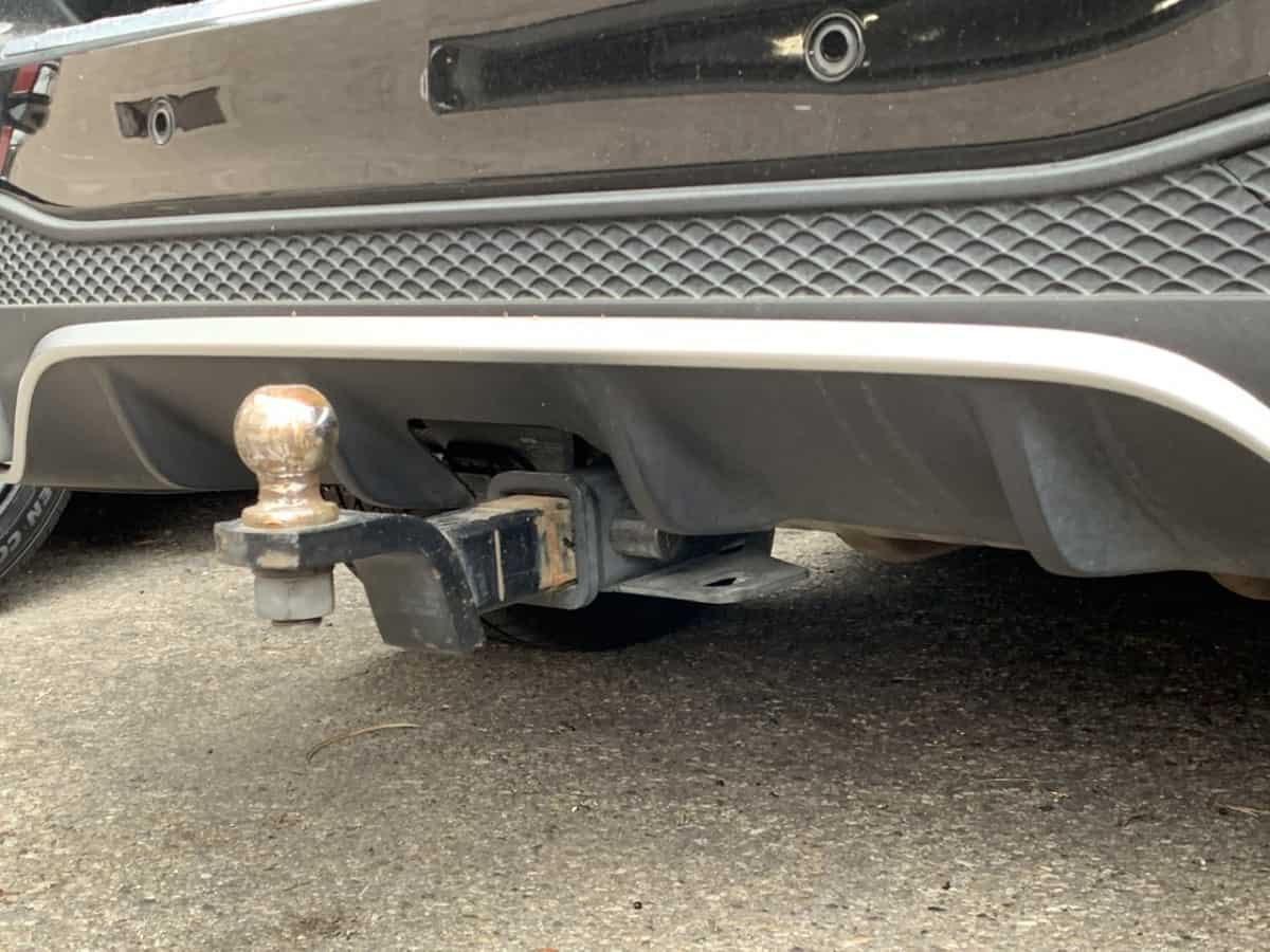 Aftermarket hitches can be installed on most vehicles but usually end up lower than factory mount