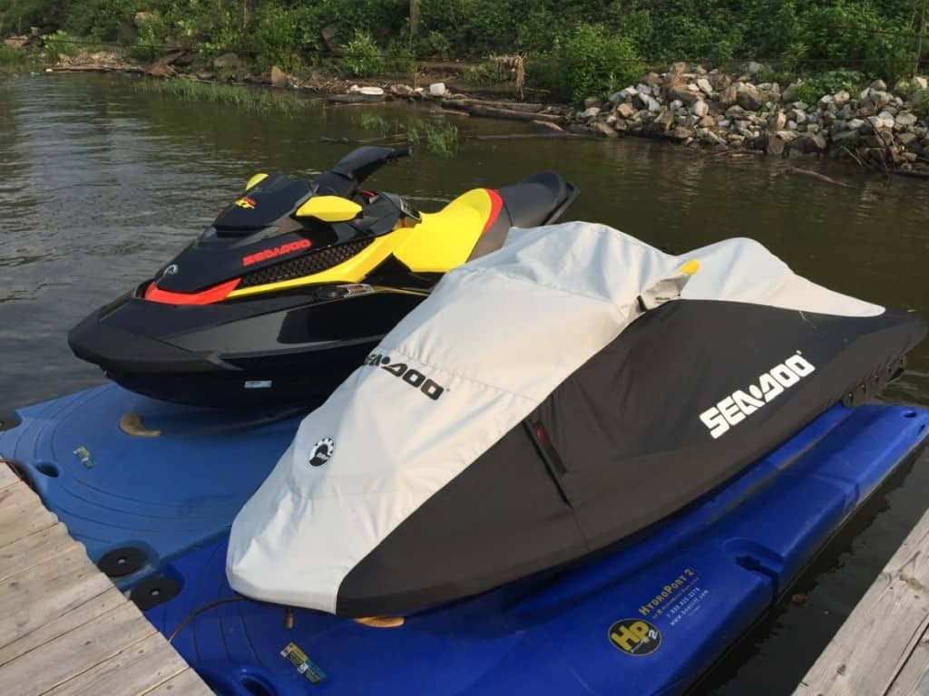 Photo of uncovered SeaDoo RXT and covered Sea Doo RXP on floating dock