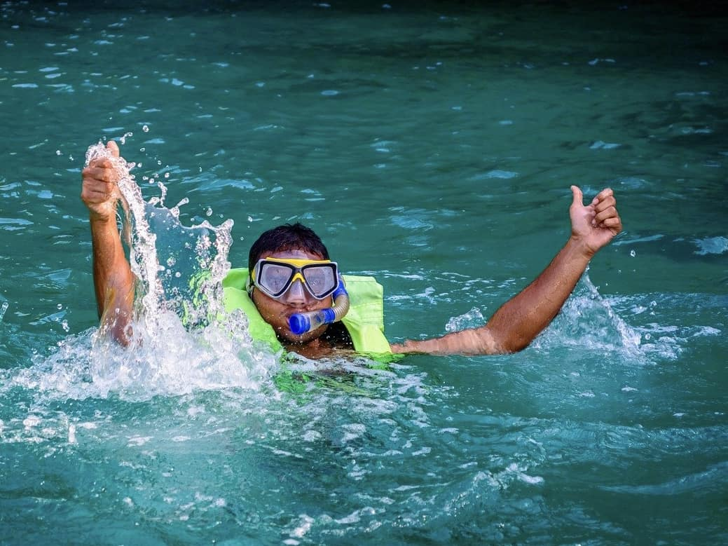 Splashing snorkeler wearing a life jacket