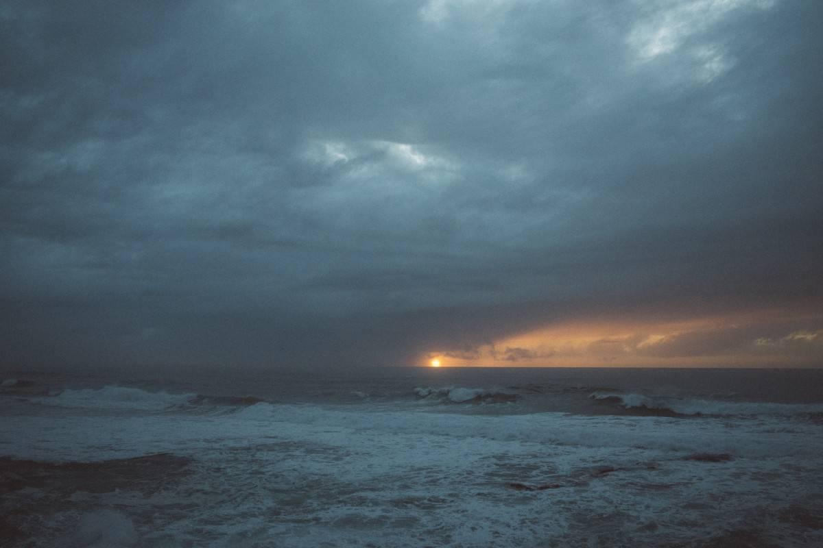 Storm over ocean at sunset