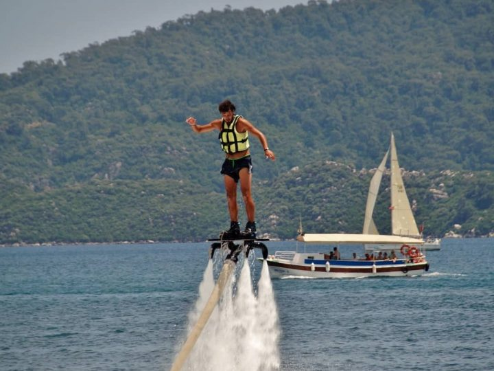 Flyboarding isn't hard if you take lessons. This image shows a new flyboarder 6 feet above water