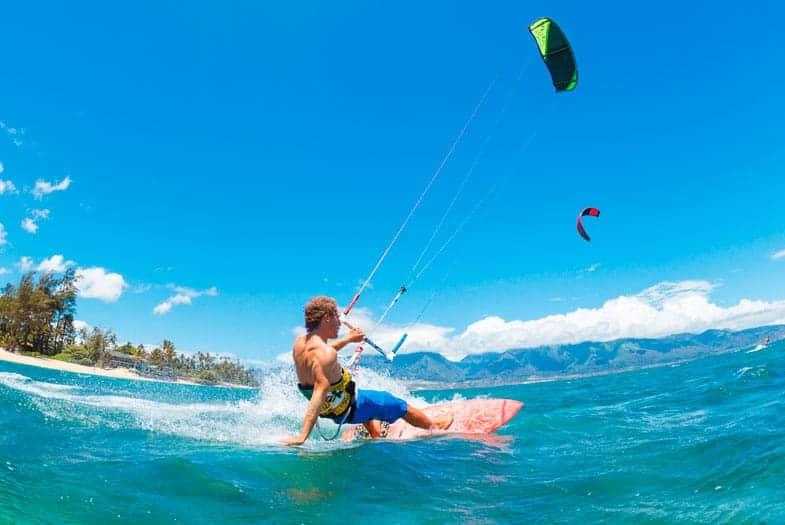 A guy kitesurfing