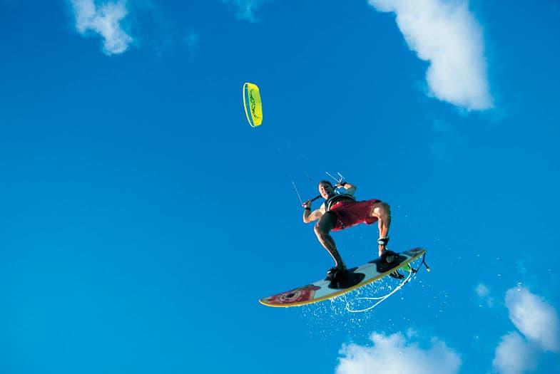 A kitesurfer high in the air