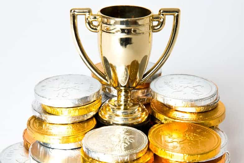 A prize cup with money laying around
