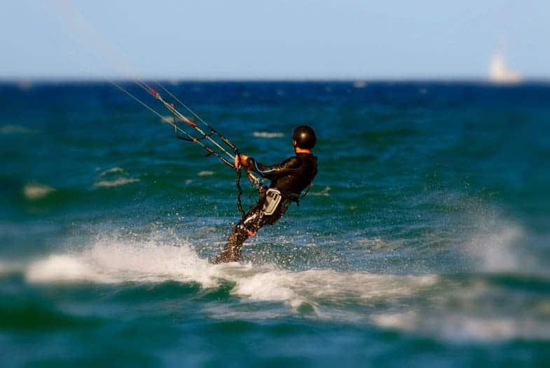 Guy kitesurfing