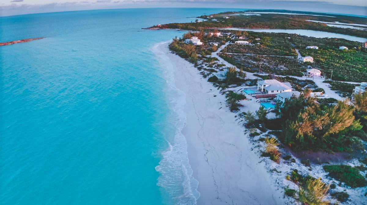 Bahamas snorkeling in crystal clear water as seen from this high drone image of a beach